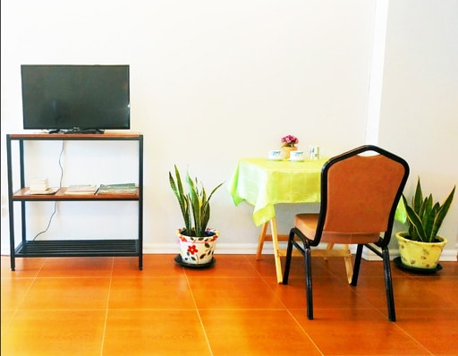 Television and dining table in Condo A-Jaan Lah